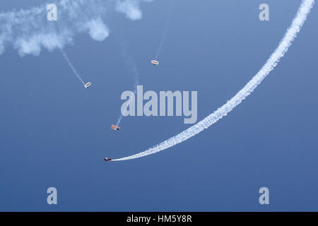 Lucas Oil Jump Team and Smoke Aircraft - Stock Photo
