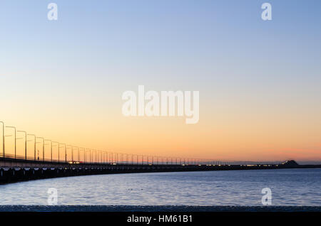 Twilight by the Oland Bridge, connecting the island Oland with mainland Sweden - Stock Photo