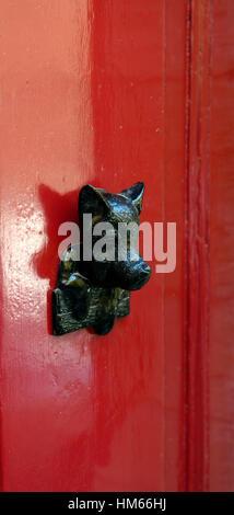 boar pig door knocker handle red doors feature design home house Valletta Malta renowned known associated tourism - Stock Photo