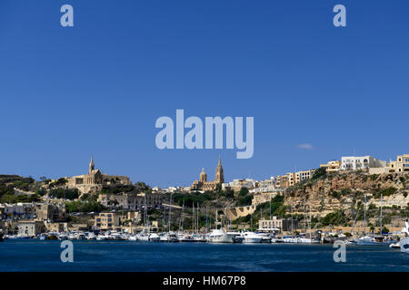Mgarr Harbour Gozo Island Malta Our Lady of Lourdes Chapel Church Catholic religion promontory overlooking tour - Stock Photo