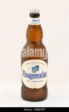 KIEV, UKRAINE - JULY 14, 2012: Hoegaarden wheat Belgian beer cold bottle against white. Hoegaarden beer is unfiltered - Stock Photo