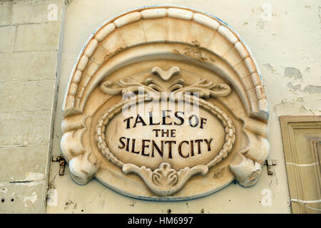 tales of the silent city sandstone wall decoration Mdina Malta Old Capital side street streets old historical walled - Stock Photo