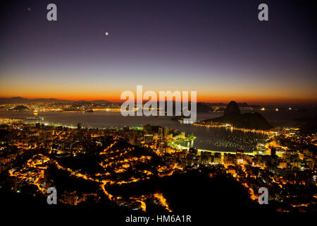 Dawn at Botafogo Bay as seen from Dona Marta lookout with sugarloaf in the distance, Rio de Janeiro, Brazil - Stock Photo