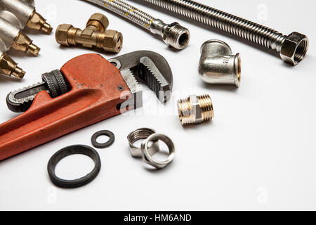 plumbing tools and equipment on white background with copy space - Stock Photo