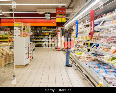 Woman shopping at the Carrefour Market store, Cremona, Italy - Stock Photo