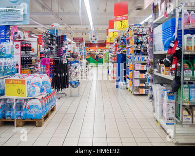 Main aisle at the Carrefour Market store, Cremona, Italy - Stock Photo