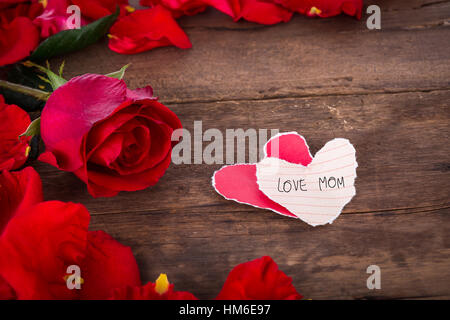 two heart shaped paper on wood with decoration of red rose valentine background stock