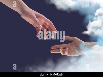 Two hands reaching towards each other against blue sky background - Stock Photo