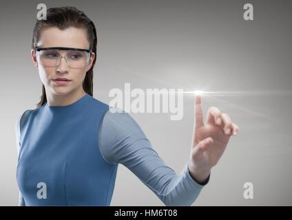 Woman using futuristic touch screen - Stock Photo