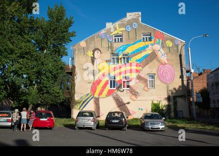 Colorful wall art on an old building, Kaunas, Lithuania - Stock Photo