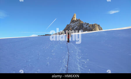 Climber on the glacier toward the Dent du Geant - Stock Photo