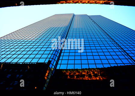 Reflection of a Building when Sunset is approaching - Stock Photo