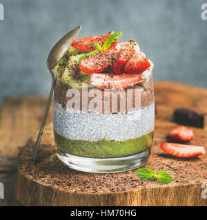 Healthy breakfast concept in glass over wooden board - Stock Photo