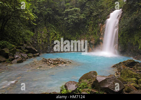 Rio Celeste (Blue River) waterfall in Tenorio Volcano National Park, Costa Rica.  The blue coloration is a result - Stock Photo