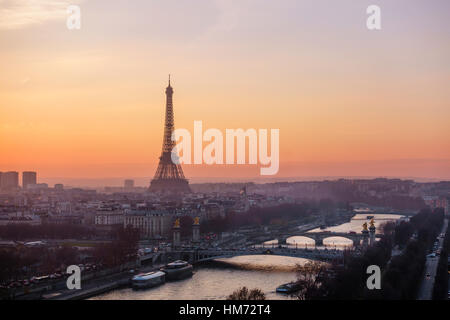 The Eiffel Tower at sunset in Paris, France - Stock Photo