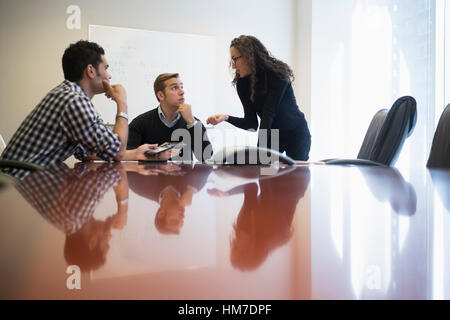 Young business people having meeting in board room - Stock Photo
