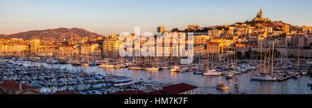 France, Provence-Alpes-Cote d'Azur, Marseille, Notre-Dame de la Garde above Vieux port - Old Port - Stock Photo