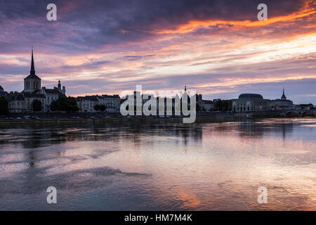 France, Pays de la Loire, Saumur, City waterfront at sunset - Stock Photo