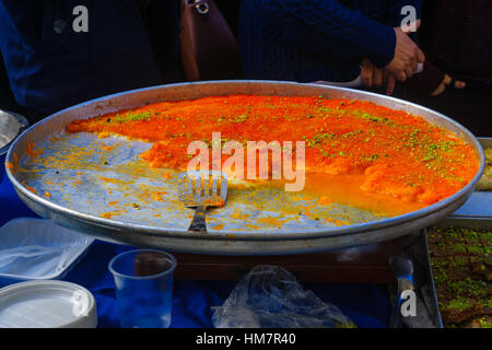 Kanafah, on sale on the market. It is a Middle Eastern cheese pastry soaked in sweet, sugar-based syrup - Stock Photo