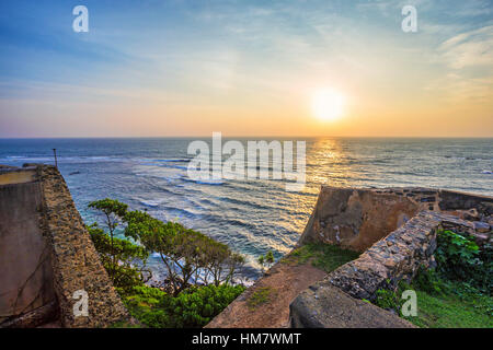 Scenic view of sunrise from walls at fort Galle - Stock Photo