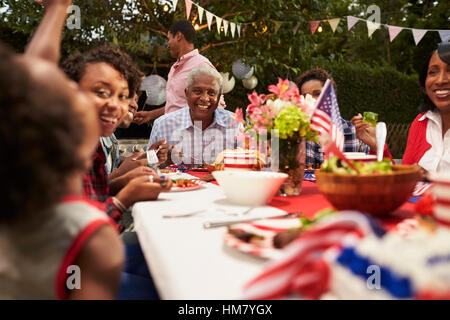 Multi generation black family at 4th July barbecue, close up - Stock Photo