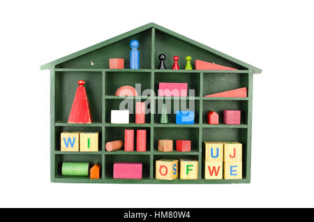 vintage green wooden box shelf with toys isolated on white - Stock Photo