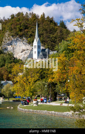 Autumn view of St Martins Parish Church along Lake Bled, Bled, Upper Carniola, Slovenia - Stock Photo