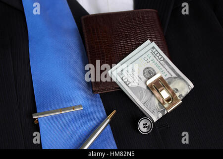 Tie, money in a clip on a suit with a shirt - Stock Photo