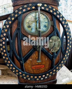 Victorian clocking in machine fish eye effect - Stock Photo