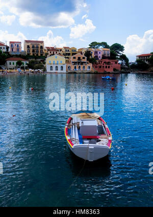 A Greek fishing boat leading into the bay of Assos on the Island of Kefalonia in Greece - Stock Photo