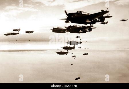 USS ESSEX based TBMs and SB2Cs dropping bombs on Hokadate, Japan.  July 1945.  (Navy) Exact Date Shot Unknown NARA - Stock Photo