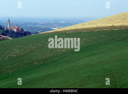 Agricultural landscape and view of the Savignano sul Panaro church, Emilia-Romagna, Italy. - Stock Photo