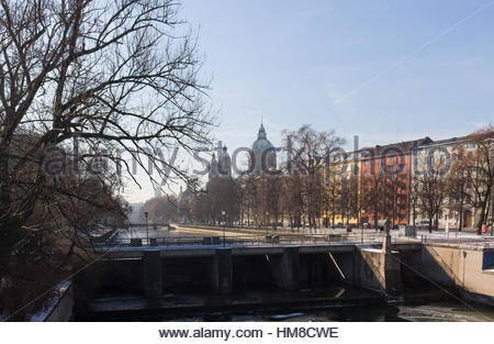 MUNICH – JANUARY 28: View on a city center from the bridge on river Isar in Munich, Germany. View on St. Luke's - Stock Photo