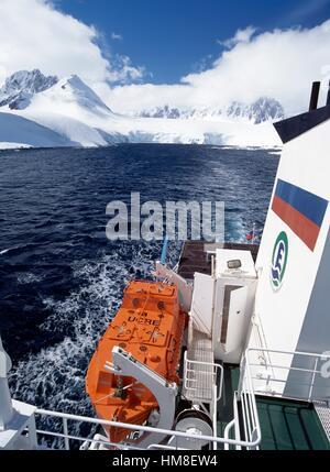 Ice-breaker research ship MS Grigory Mikheev, West coast of the Antarctic peninsula, Antarctica. - Stock Photo