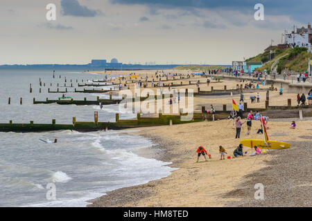 Holidaymakers on a sandy beach in a quaint seaside town of Southwold on the Saffolk Noarth Sea coast. - Stock Photo