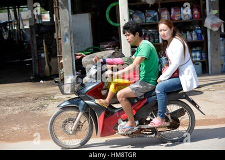 A family on motorbike in Laos, South East Asia. - Stock Photo
