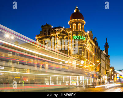 Newcastle upon Tyne, England, United Kingdom. Buses passing the famous Northern Goldsmiths building on Blackett - Stock Photo