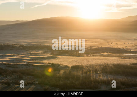 View of a valley and mountains at sunrise from the  Henshaw Scenic View vista point. San Diego County, California, - Stock Photo