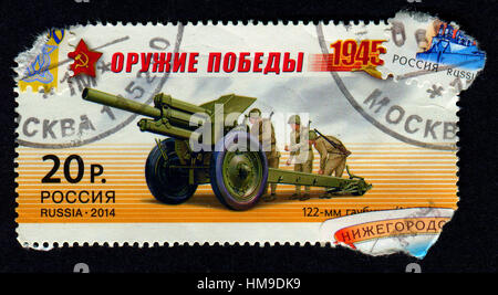 Stamp printed in Russia shows image of the 122 mm howitzer M1938 (M-30) was a Soviet 121.92 mm (4.8 inch) howitzer, - Stock Photo