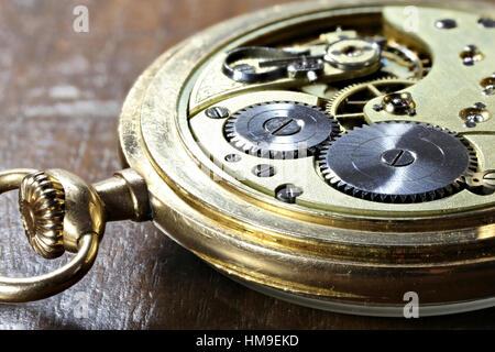 clockwork of an antique Swiss 14k gold pocket watch - Stock Photo