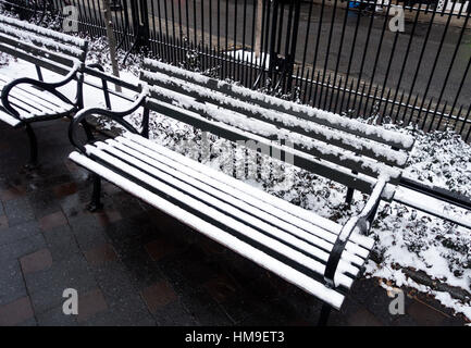 An empty pack bench in winter - Stock Photo