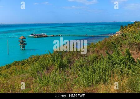 An overlook onto the beautiful caribbian water on Isla Mujeres, Mexico. - Stock Photo