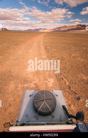 Offroad vehicle oldtimer driving off road in Morocco - Stock Photo