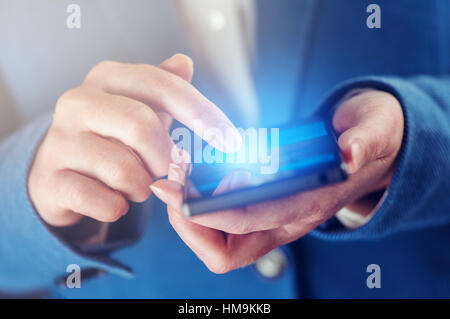 Businesswoman typing SMS message on smart phone device, business communication and connectivity - Stock Photo