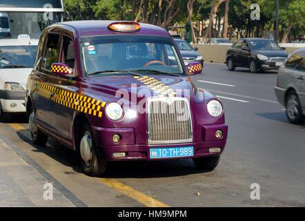Baku, Azerbaijan - September 10, 2016: Baku city taxi on the street. The people called eggplant taxis due to its - Stock Photo