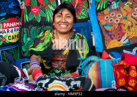 Kuna women sell their molas to the tourists. Panama City Casco Viejo kuna indian traditional handicraft items sellers - Stock Photo