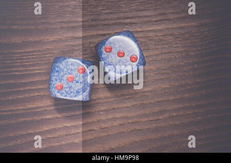 two blue dice on a wooden surface - copy space - Stock Photo