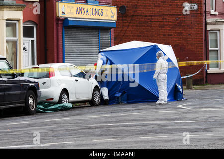 Liverpool, UK. 2nd Feb, 2017. Forensic officers comb the murder scene after a 26 yr old man was shot dead in the - Stock Photo