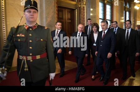 Russian President Vladimir Putin walks with Hungarian Prime Minister Viktor Orban, right, during his visit February - Stock Photo