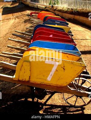 Multi colored wood wheelbarrows are lined up for the Johnny Studebaker Race at the El Dorado County Fairgrounds - Stock Photo
